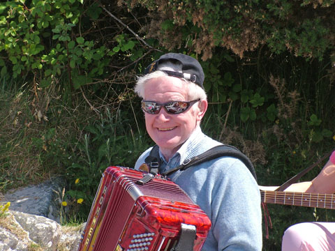 Photo of Graham our oldest musician, resident box player and star of many a session